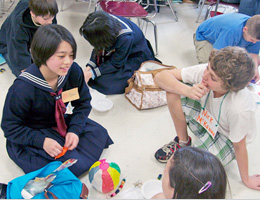 Students talking about Japanese games at Rising Tide Charter School, Plymouth, Massachusetts